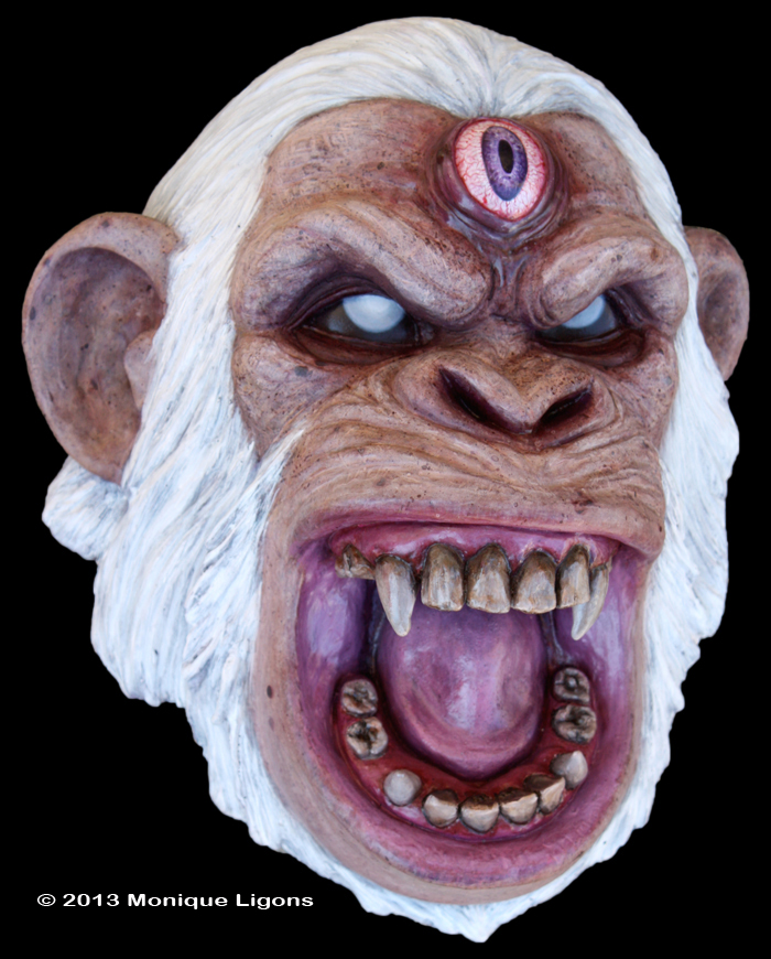 Angry white chimp with a third eye sculpture